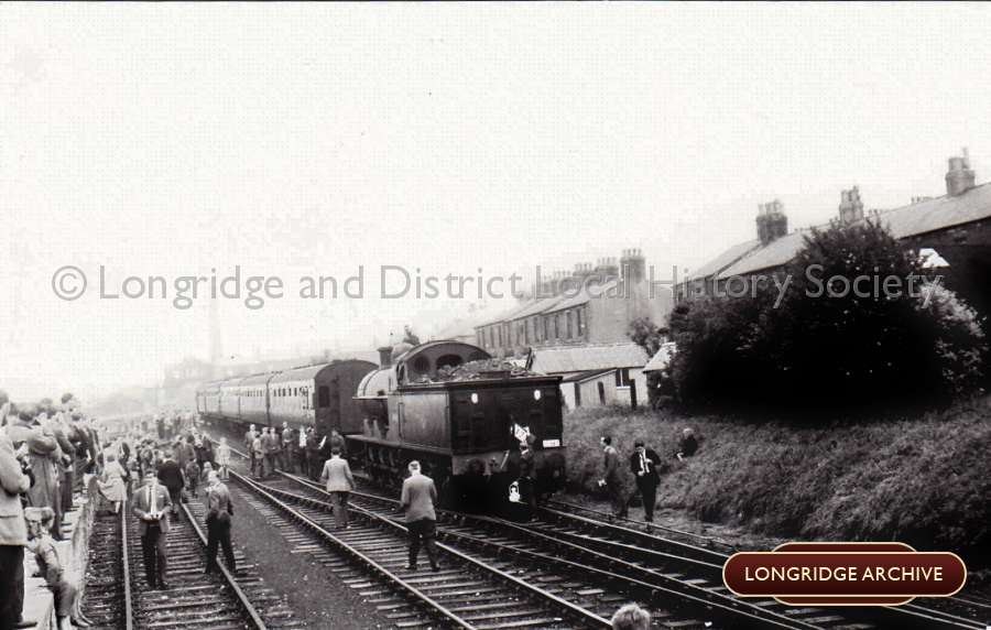 A Train And Crowds At Longridge Station
