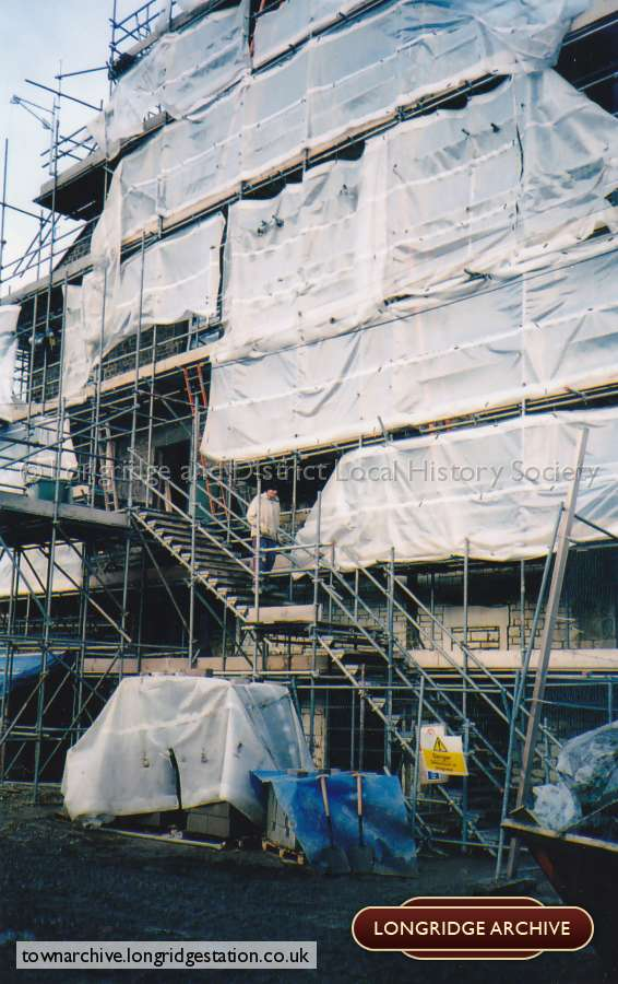 Scaffolding Covers The Rear Of The Co-op Building